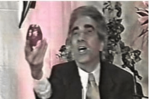 A talk show host holds up an apple and asks a caller to confirm what kind of fruit it is. Image: Fardin Alikhah