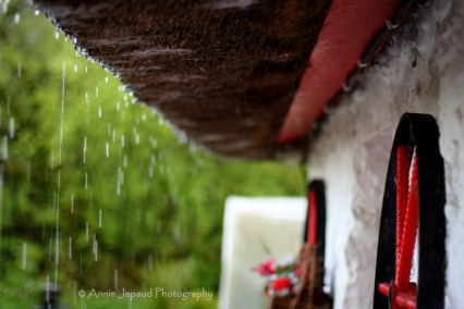 rain dripping from thatched roof