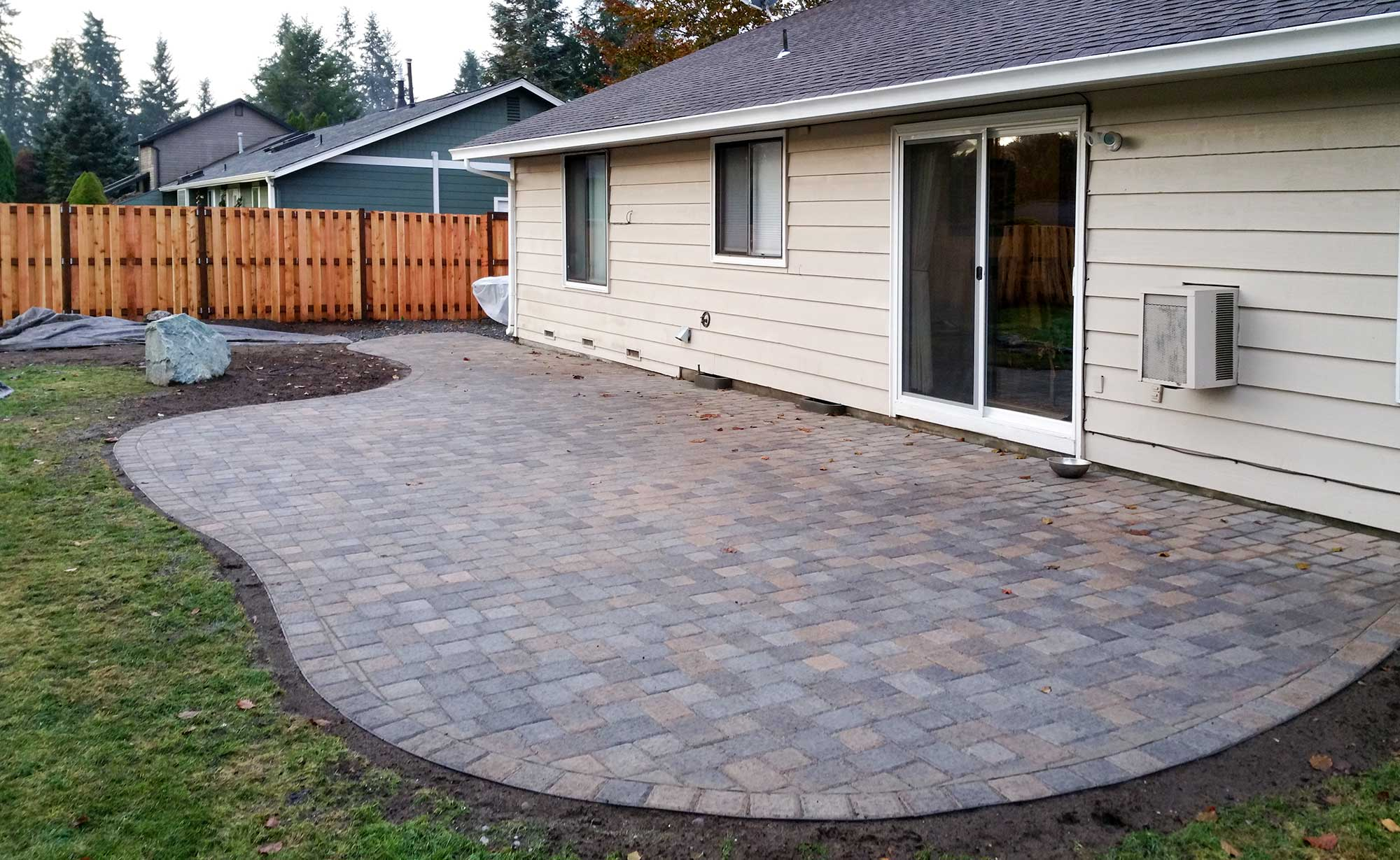 Concrete and Paver patio installation in Olympia and Tacoma Puget Sound  AJB Landscaping  Fence