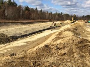 Installing underdrain in detention ponds