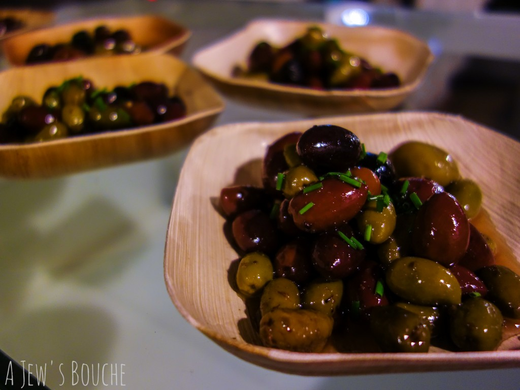 A glass of prosecco and a dish of house-cured olives as a welcoming treat.