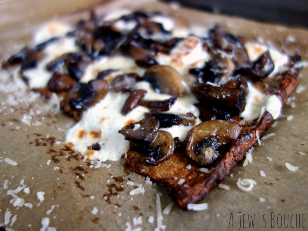 Cauliflower-crust pizza with a blend of steeped wild and domesticated mushrooms, fresh mozzarella, Brent The Cheese Guy's 2-year aged Parmesan, truffle oil, and smoked sea salt. The stuff dreams are made of.