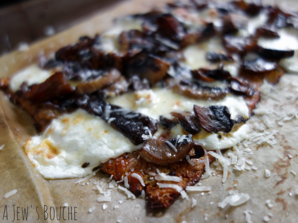 Cauliflower-crust pizza with a blend of steeped wild and domesticated mushrooms, fresh mozzarella (only Basil's is better), Brent The Cheese Guy's 2-year aged Parmesan, truffle oil, and smoked sea salt. The stuff dreams are made of.