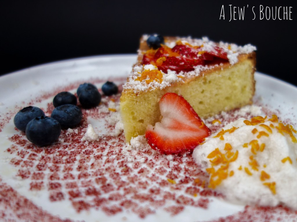 Olive Oil Cake with Walnut Snow, Raspberry Dust, & Honey Rosemary Whipped Cream