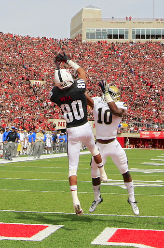 Nebraska wide receiver Kenny Bell (80) catches a touchdown pass over UCLA cornerback Fabian Moreau (10) in the first half of an NCAA college football game in Lincoln, Neb., Saturday, Sept. 14, 2013. (AP Photo/Nati Harnik)