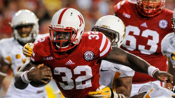 LINCOLN, NE - AUGUST 31: Running back Imani Cross #32 of the Nebraska Cornhuskers scores a touchdown during their game against the Wyoming Cowboys at Memorial Stadium on August 31, 2013 in Lincoln, Nebraska. (Photo by Eric Francis/Getty Images)