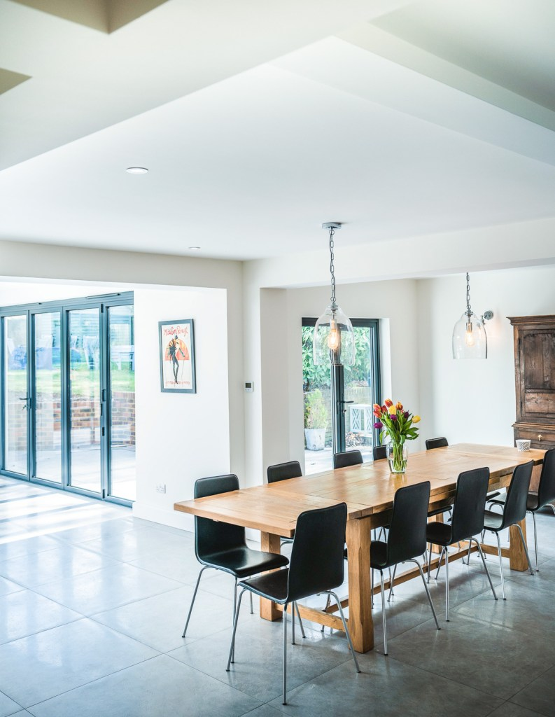 Open plan dining room and kitchen house renovation with bi-fold doors in Bexhill, East Sussex