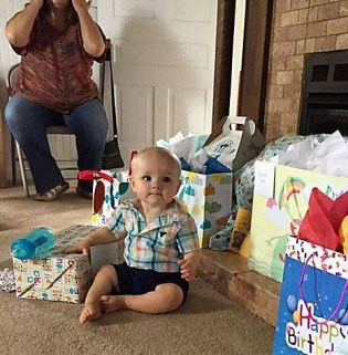 Opening gifts (me in background)
