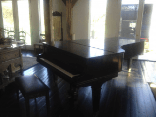 Piano moved by A & J Moving of Mineola NY