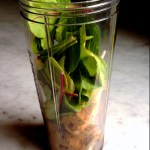 spinach added to smoothie cup