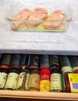 a spice drawer just below the counter top makes prepping foods easy
