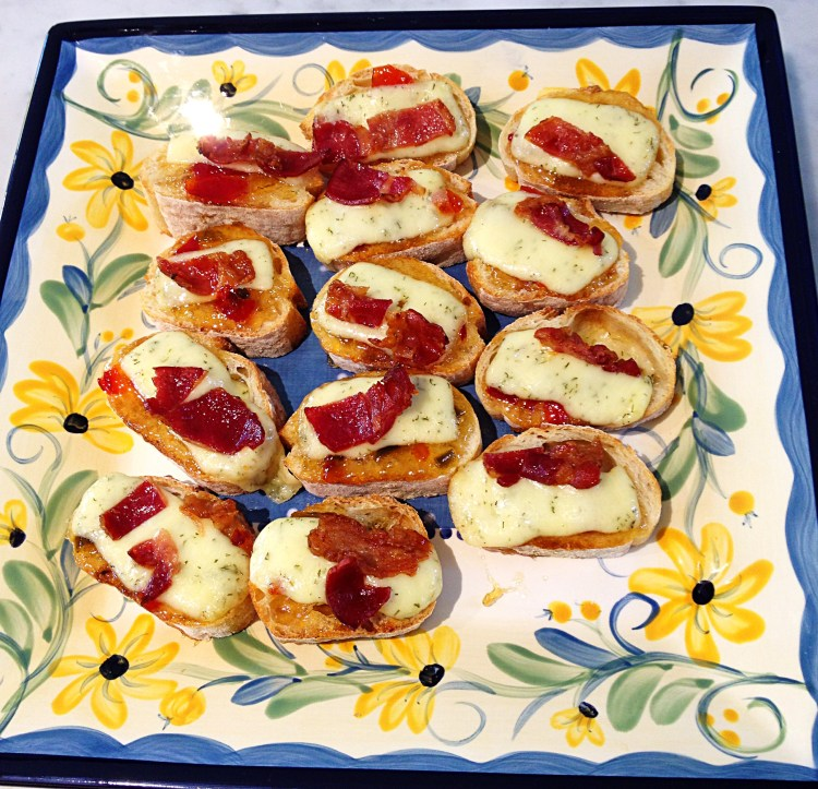 baguette rounds topped with pepper jelly, Havarti cheese, and bacon crumbles.