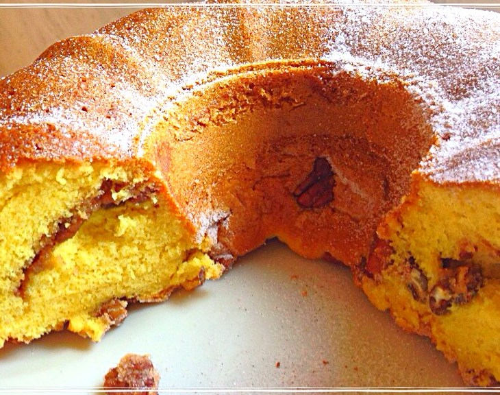 An easy coffee cake recipe with yellow cake and vanilla pudding, nuts, and sugar cinnamon