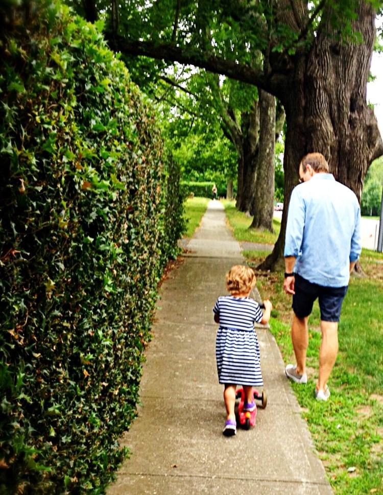 Photo of father and daughter enjoying a walk in Bridgehampton.