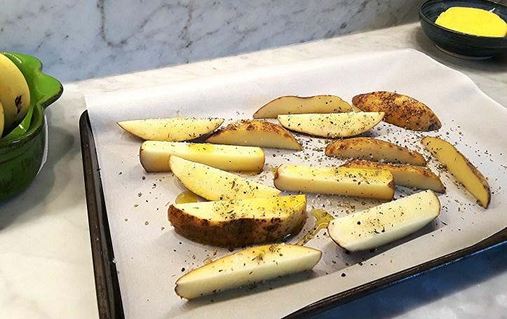 potatoes seasoned and ready to bake