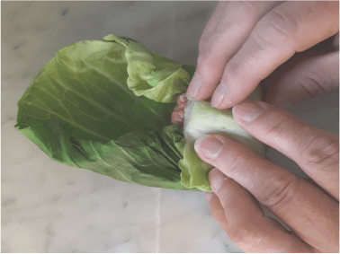 rolling the cabbage