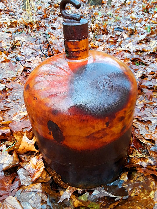 Welded copper garden bell oxidizes in the weather