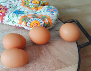 four brown eggs