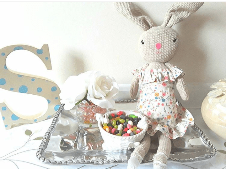 Easter vingette with bunny doll, jelly beans, white roses, and large wooden letter S
