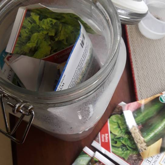 Seed packets are stored in gladd jars with tight lids.