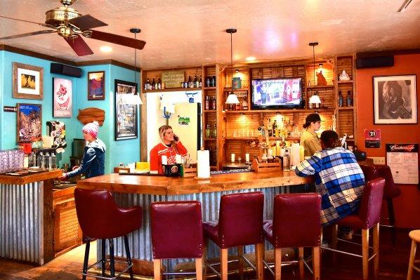 Photo of barbecue restaurant bar, padded bar stools