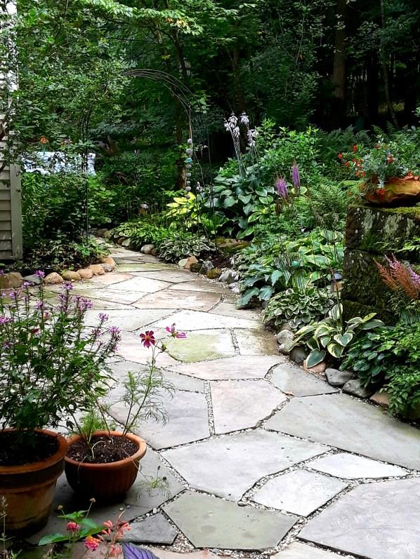 a bluestone path leads through the garden