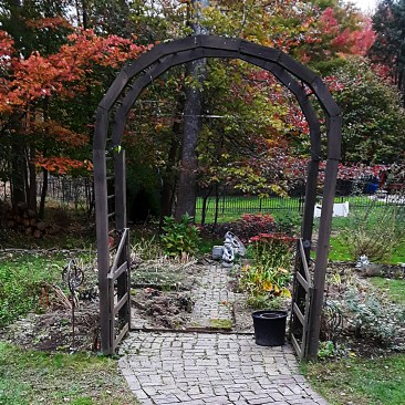 The arch remains, but the rest of the garden fence has been taken down.