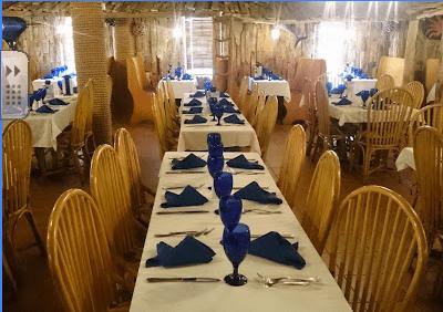 Tables set for dinner at Driftwood restaurant.