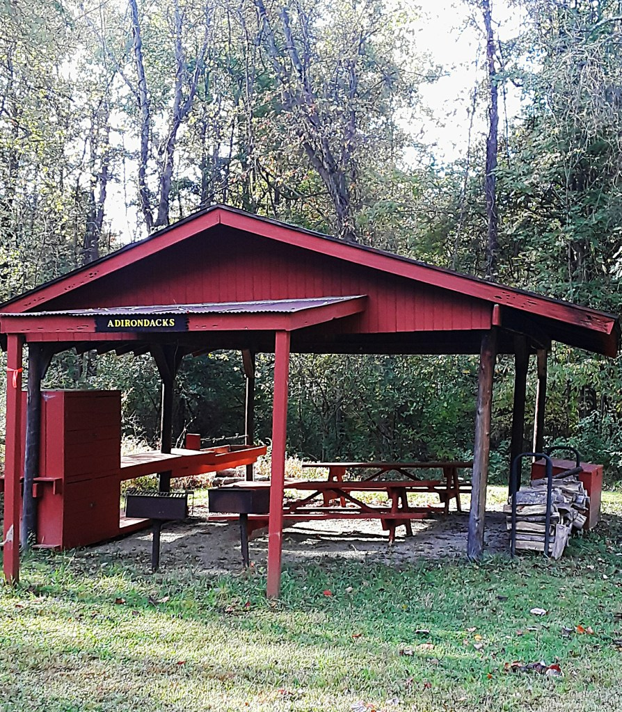 A picnic shelter along the trail covers two tables and two grills