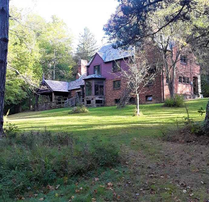back of Amity House with lush lawn