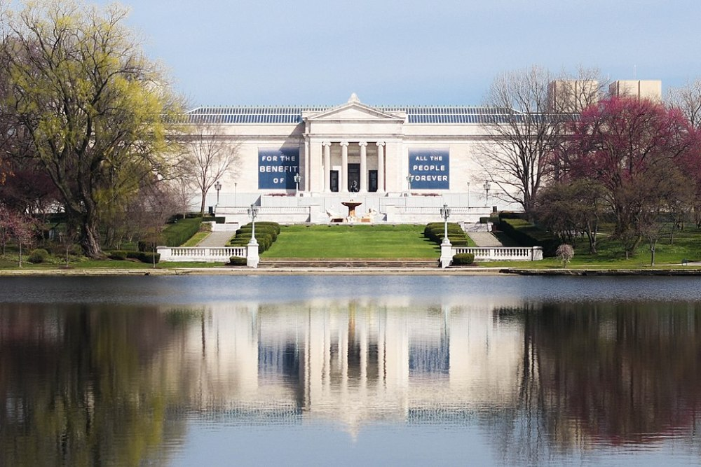 The classic architecture of The Cleveland Museum of Natural History is reflected in its man-made pond.