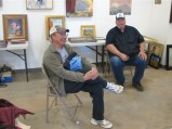 Artists Denny Carriere and Terry McVey drop by for a quick look.