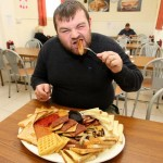 Man Eating too Much Food