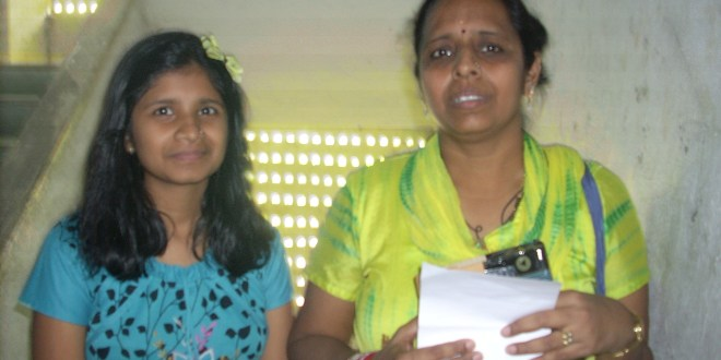 Courier Woman - Bharti Mahto and her Daughter Jui.