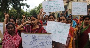 About 70 women self-help group members from a village in West Bengal attend a rally against alcoholism and associated gender-based violence.
