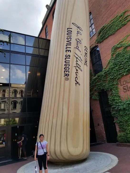 Girl with Louisville Slugger baseball Bat