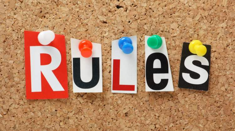 """rules"" spelled out on corkboard"