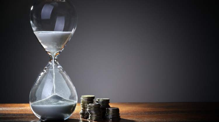 hourglass and coins - MA expresses PBS cuts concerns