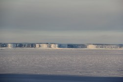 An incredible Fata Morgana seen along the coast of Cape Hodgson, Black Island, and at the Pegasus Airfield, out in the middle of the Ross Ice Shelf. The Pegasus buildings appear much taller and bigger than they actually are. © A. Padilla