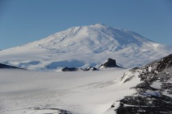 A great view of the rest of the Ross Island on a beautiful sunny and clear day, with Mt. Erebus looming in the distance above Castle Rock. © A. Padilla