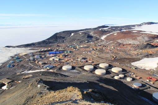 A contrasting view of McMurdo Station from the top of Ob Hill, later in the summer without the white blanket of snow. © A. Padilla