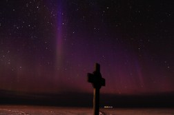 Vince's Cross, at Hut Point, and a dramatic shift in color of the Aurora Australis. © A. Padilla