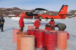 Inspecting fuel barrels at Odell Glacier, Antarctica. © A. Padilla