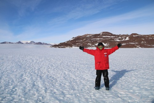Abe on blue ice at Odell Glacier, Antarctica, with the Allan Hills in the background. © A. Padilla