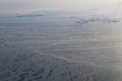 Sea ice on the McMurdo Sound, Antarctica, and Ross Island in the background. © A. Padilla