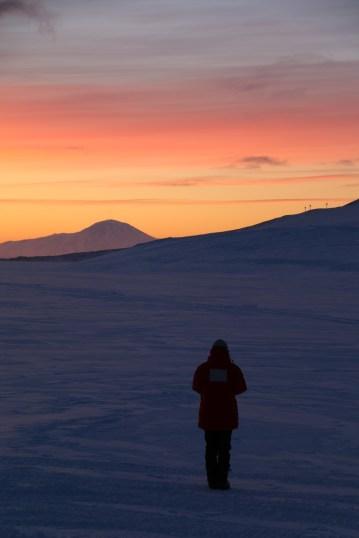 Carolyn enjoys a radiant Antarctic sunset over the Ross Ice Shelf. © A. Padilla