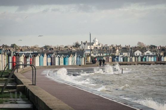 Walking by the beach huts at high tide, Brightlingsea