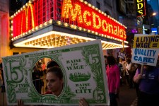 Protestors demonstrate for a 15 dollar minimum wage in front of McDonalds