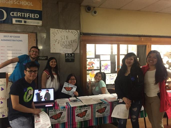 A group of students table at their school to promote the sanctuary program
