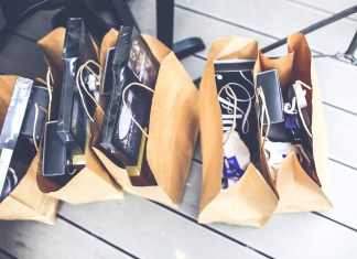 brown shopping bags filled with consumer purchases